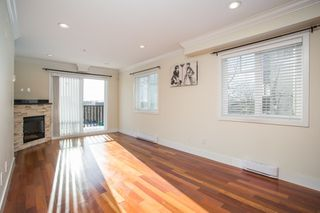 Photo 2: 1051 W 72ND Avenue in Vancouver: Marpole Townhouse for sale (Vancouver West)  : MLS®# R2429562