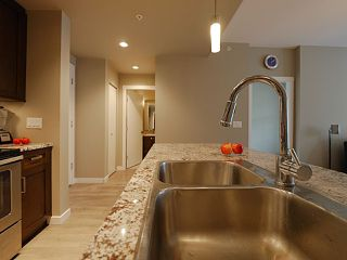 "Photo 19: 406 2242 WHATCOM Road in Abbotsford: Abbotsford East Condo for sale in ""Waterleaf"" : MLS®# R2474178"