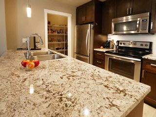 "Photo 14: 406 2242 WHATCOM Road in Abbotsford: Abbotsford East Condo for sale in ""Waterleaf"" : MLS®# R2474178"