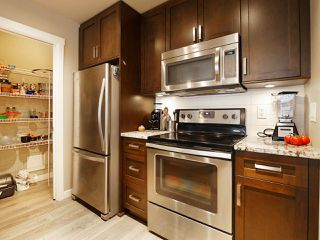 "Photo 16: 406 2242 WHATCOM Road in Abbotsford: Abbotsford East Condo for sale in ""Waterleaf"" : MLS®# R2474178"