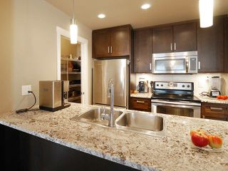 "Photo 13: 406 2242 WHATCOM Road in Abbotsford: Abbotsford East Condo for sale in ""Waterleaf"" : MLS®# R2474178"