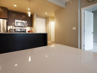 "Photo 12: 406 2242 WHATCOM Road in Abbotsford: Abbotsford East Condo for sale in ""Waterleaf"" : MLS®# R2474178"