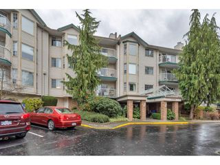 "Photo 1: 206 5360 205 Crescent in Langley: Langley City Condo for sale in ""PARKWAY ESTATES"" : MLS®# R2516417"