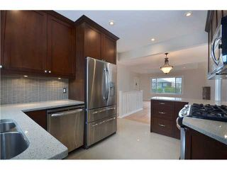 Photo 4: 4847 HENRY Street in Vancouver: Knight House for sale (Vancouver East)  : MLS®# V996847