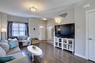 Photo 4: 257 Ranch Ridge Meadow: Strathmore Row/Townhouse for sale : MLS®# C4295483