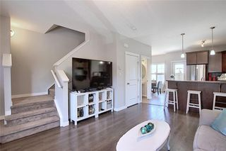 Photo 3: 257 Ranch Ridge Meadow: Strathmore Row/Townhouse for sale : MLS®# C4295483