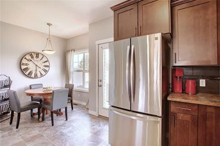 Photo 11: 257 Ranch Ridge Meadow: Strathmore Row/Townhouse for sale : MLS®# C4295483