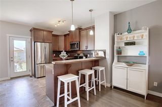 Photo 5: 257 Ranch Ridge Meadow: Strathmore Row/Townhouse for sale : MLS®# C4295483