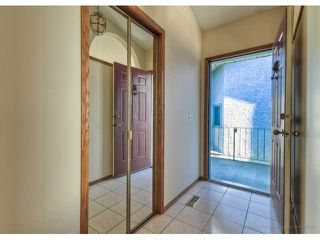 Photo 2: 723 WOODBINE Boulevard SW in CALGARY: Woodbine Residential Attached for sale (Calgary)  : MLS®# C3584095