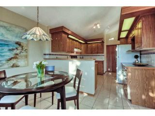 Photo 8: 723 WOODBINE Boulevard SW in CALGARY: Woodbine Residential Attached for sale (Calgary)  : MLS®# C3584095