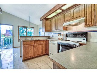 Photo 6: 723 WOODBINE Boulevard SW in CALGARY: Woodbine Residential Attached for sale (Calgary)  : MLS®# C3584095