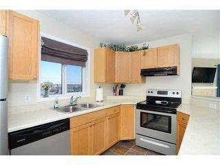 Photo 3: 2302 20 HARVEST ROSE Park NE in CALGARY: Harvest Hills Condo for sale (Calgary)  : MLS®# C3564671