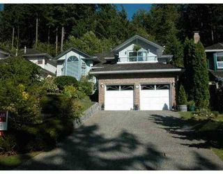 Photo 1: 10 FLAVELLE DR in Port Moody: Barber Street House for sale : MLS®# V555384