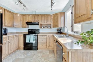 Photo 6: 110 GLAMIS Terrace SW in Calgary: Glamorgan Row/Townhouse for sale : MLS®# C4290027