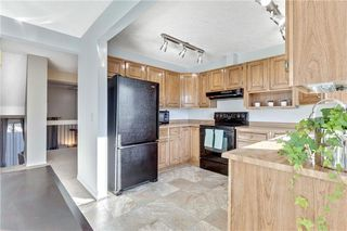 Photo 4: 110 GLAMIS Terrace SW in Calgary: Glamorgan Row/Townhouse for sale : MLS®# C4290027