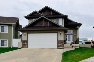 Main Photo: 12 Iron Wolf Close in Lacombe: Iron Wolf Residential for sale : MLS®# CA0194088