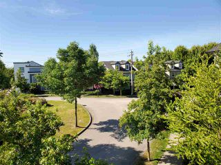 "Photo 19: 30 11067 BARNSTON VIEW Road in Pitt Meadows: South Meadows Townhouse for sale in ""COHO"" : MLS®# R2476146"