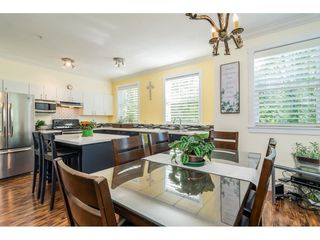 """Photo 27: 30 11067 BARNSTON VIEW Road in Pitt Meadows: South Meadows Townhouse for sale in """"COHO"""" : MLS®# R2476146"""