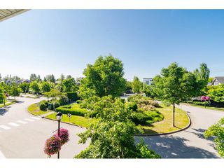"Photo 18: 30 11067 BARNSTON VIEW Road in Pitt Meadows: South Meadows Townhouse for sale in ""COHO"" : MLS®# R2476146"