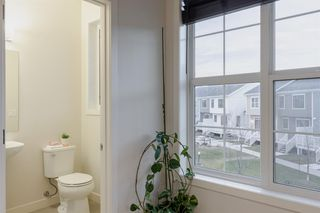 Photo 18: 32 Sherwood Row NW in Calgary: Sherwood Row/Townhouse for sale : MLS®# A1047885