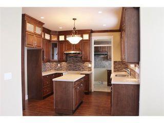 Photo 5: 14457 71ST AV in Surrey: East Newton House for sale : MLS®# F1325738