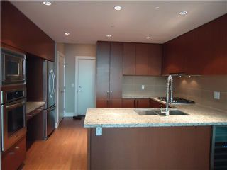 "Photo 1: 1209 1155 THE HIGH Street in Coquitlam: North Coquitlam Condo for sale in ""M One"" : MLS®# V935691"