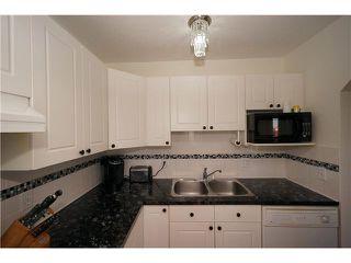 Photo 5: 26 567 EDMONTON Trail NE: Airdrie Townhouse for sale : MLS®# C3578088