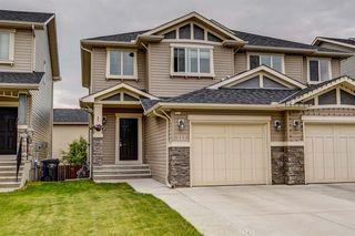 Photo 1: 113 BRIGHTONCREST Grove SE in Calgary: New Brighton Semi Detached for sale : MLS®# A1017017