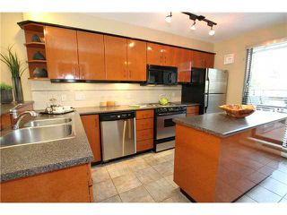 """Photo 2: 850 GREENCHAIN Street in Vancouver: False Creek Townhouse for sale in """"HEATHER POINT"""" (Vancouver West)  : MLS®# V946161"""