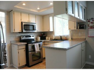 Photo 4: 7325 142A ST in Surrey: East Newton House for sale