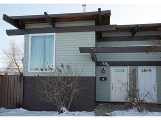 Photo 17: 86 QUEEN ALEXANDRA Close SE in CALGARY: Queensland Townhouse for sale (Calgary)  : MLS®# C3554495