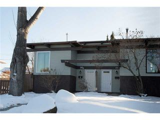 Photo 18: 86 QUEEN ALEXANDRA Close SE in CALGARY: Queensland Townhouse for sale (Calgary)  : MLS®# C3554495