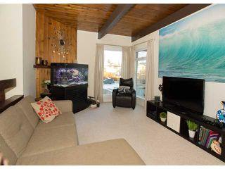 Photo 7: 86 QUEEN ALEXANDRA Close SE in CALGARY: Queensland Townhouse for sale (Calgary)  : MLS®# C3554495