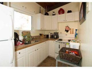 Photo 11: 86 QUEEN ALEXANDRA Close SE in CALGARY: Queensland Townhouse for sale (Calgary)  : MLS®# C3554495