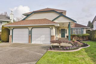 Photo 1: 3747 BRACEWELL Court in Port Coquitlam: Oxford Heights House for sale : MLS®# V994822