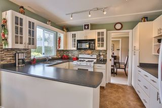 Photo 6: 3747 BRACEWELL Court in Port Coquitlam: Oxford Heights House for sale : MLS®# V994822