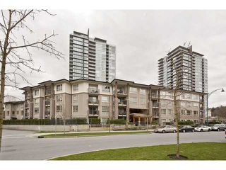 "Photo 1: 312 701 KLAHANIE Drive in Port Moody: Port Moody Centre Condo for sale in ""NAHANNI"" : MLS®# V936161"