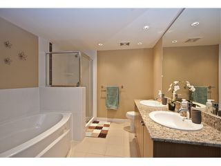 "Photo 7: 312 701 KLAHANIE Drive in Port Moody: Port Moody Centre Condo for sale in ""NAHANNI"" : MLS®# V936161"