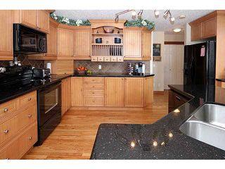 Photo 5: 71 GLENEAGLES Terrace: Cochrane Residential Detached Single Family for sale : MLS®# C3562538