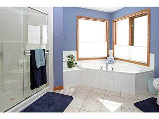 Photo 14: 71 GLENEAGLES Terrace: Cochrane Residential Detached Single Family for sale : MLS®# C3562538