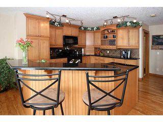 Photo 4: 71 GLENEAGLES Terrace: Cochrane Residential Detached Single Family for sale : MLS®# C3562538