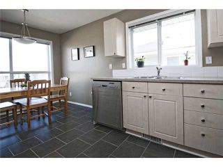 Photo 6: 113 55 FAIRWAYS Drive NW: Airdrie Townhouse for sale : MLS®# C3565868