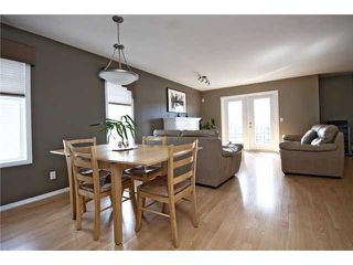 Photo 5: 113 55 FAIRWAYS Drive NW: Airdrie Townhouse for sale : MLS®# C3565868