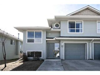 Photo 1: 113 55 FAIRWAYS Drive NW: Airdrie Townhouse for sale : MLS®# C3565868