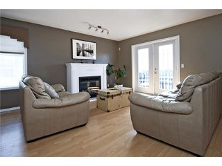 Photo 3: 113 55 FAIRWAYS Drive NW: Airdrie Townhouse for sale : MLS®# C3565868