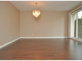 """Photo 2: 220 13888 70TH Avenue in Surrey: East Newton Townhouse for sale in """"Chelsea Gardens"""" : MLS®# F1311493"""