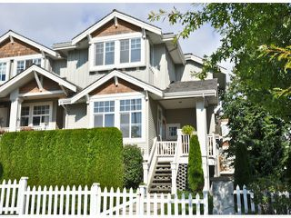 "Photo 1: 14 14877 58TH Avenue in Surrey: Sullivan Station Townhouse for sale in ""REDMILL"" : MLS®# F1312964"