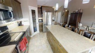 Photo 15: 418 Allwood Manor in Saskatoon: Hampton Village Residential for sale : MLS®# SK784570