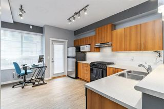 "Photo 5: 18 100 KLAHANIE Drive in Port Moody: Port Moody Centre Townhouse for sale in ""INDIGO-KLAHANIE"" : MLS®# R2473657"