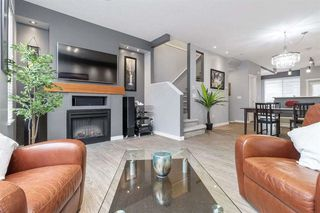 "Photo 1: 18 100 KLAHANIE Drive in Port Moody: Port Moody Centre Townhouse for sale in ""INDIGO-KLAHANIE"" : MLS®# R2473657"